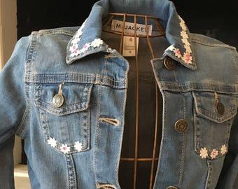 size 6 denim jacket with daisy trim