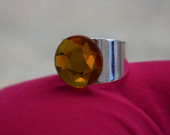 Silver-plated ring in a broad version with Bohemian Amber glass bead