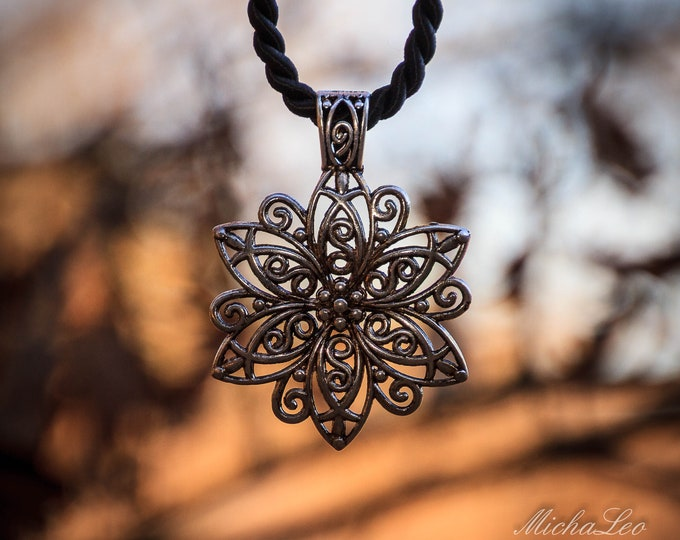 Statement antique floral necklace in braided cord and silver carabiner closure, beautifully filigree crafted pendant!
