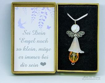 Milk glass orange angel on white satin ribbon and gift box with loving saying