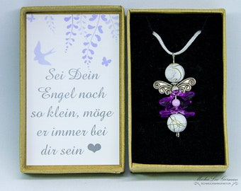 Noble angel with purple floral skirt on long white satin ribbon in gift box with lovely saying