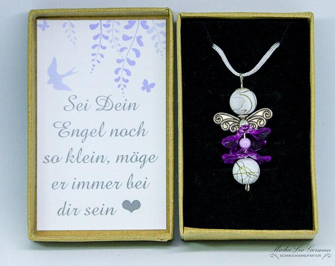 Edler Engel mit lila blumigem Röckchen auf langem weißen Satinband