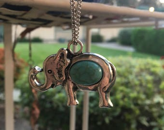 Silver Elephant with Blue Stone in Center