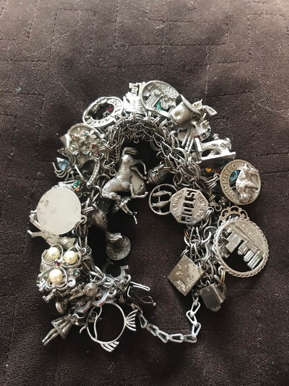 Vintage charm bracelet with 53 charms