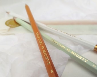 3 Pencils with This Girl Is Mighty motif, in mango, green and white