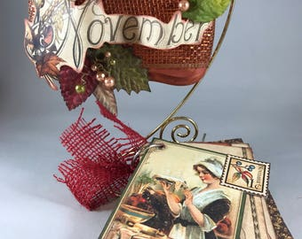 Christmas Ornament: November Ornament & Brag Book