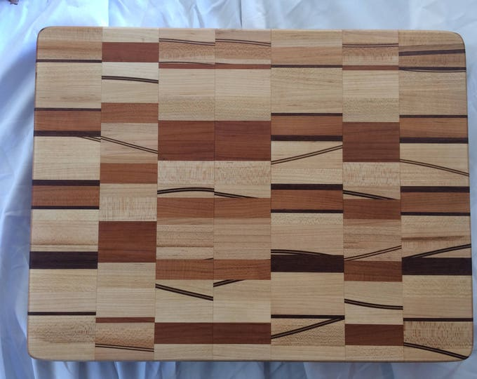 A Contrast of Order and Chaos Cutting Board with Walnut, Maple and Cherry blocks with Curved Through Thickness Inlays