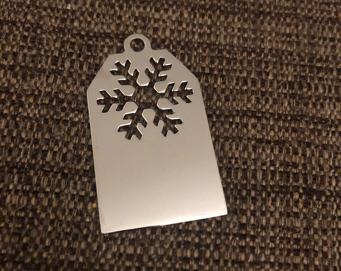 """Silver Snowflake Tag 1"""" wide x 2"""" tall"""