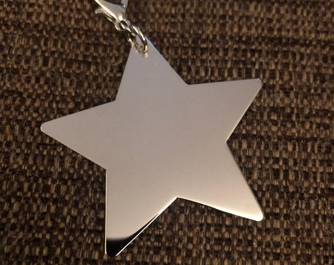 """Silver Star Tag 1"""" wide x 1.25"""" tall"""