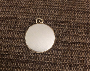 "Round pendant charm 1"" diameter- silver toned front with gold back"
