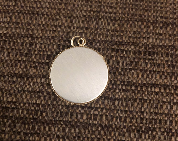 """Round pendant charm 1"""" diameter- silver toned front with gold back"""