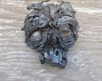 Welded metal sculpture wall mask