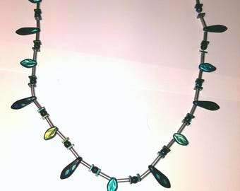 Green, blue and silver bead necklace.