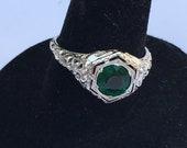 Edwardian 18k white gold lovebird design ring with emerald paste center stone engagement promise anniversary ring circa 1900.
