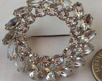 vintage sterling silver wreath brooch in clear stones which is perfect for the holidays hallmark sterling in back. circa 1950's
