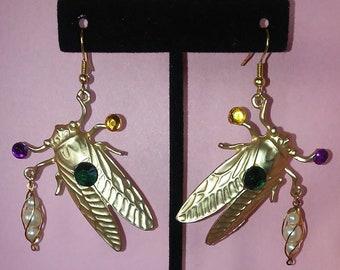 Cicada earrings with bead accents.