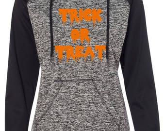 Halloween Pullover Hoodie . Tick Or Treat Scary Font Sweatshirt. loose halloween sweatshirt with hood , thumb holes . Halloween Shirts .