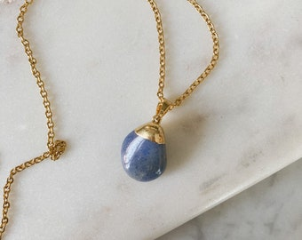 Gold necklace with polished quartz pendant / steel chain