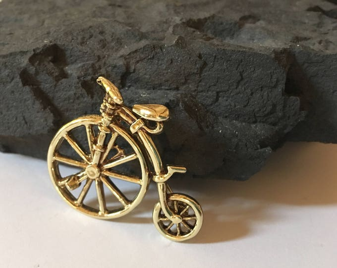 Featured listing image: Awesome Vintage retro unicycle brooch adorned in gold tone! Perfect gift for anyone!