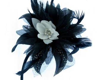 Black flower fascinator on a comb with white and diamantie center, weddings, races, party