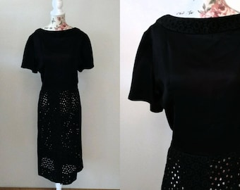 vintage 1960s black wiggle dress with see-through circle pattern