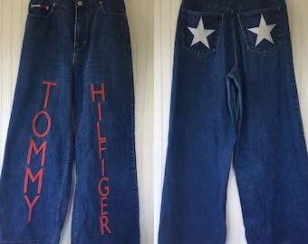 """Rare Vintage 90s Tommy Hilfiger Denim Blue Jeans Wide Leg Size 9 8 10 Large Logo Logo Nineties Hip Hop Pipe Leg 32"""" Waist 32 31 30"""