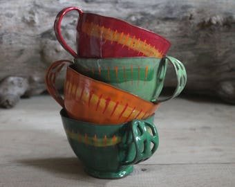 """Pottery mug """"kunterbunt and Crooked"""" in green, orange, light green, red"""