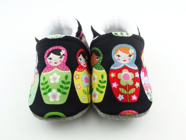 Baby leather sole and black cotton top shoes with matriochkas ideal for a birth gift