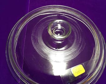 92. Round clear lid 7  3/4 inches
