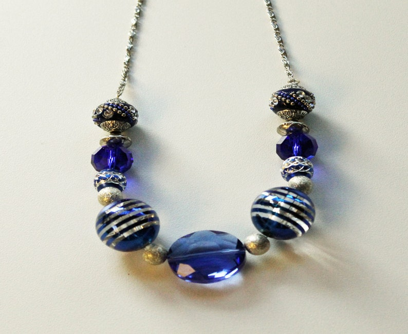 Blue Round Glass Beads and Ornate Silver and Blue Beaded Necklace.