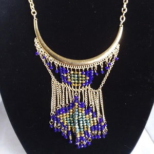 Antique gold Bib style Necklace flower details blue glass accents dangling blue black beads moon free shipping southwestern gifts for her