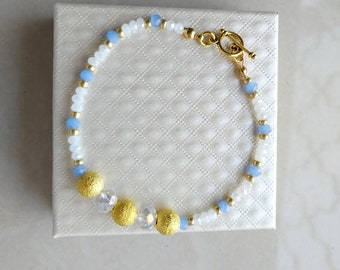 TITO A bracelet of white and blue crystals