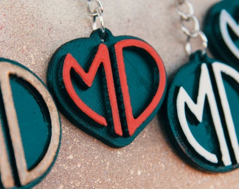 Pair of a key chains with custom monogram initials for couples