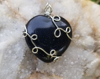 Blue goldstone wire wrapped heart pendant.