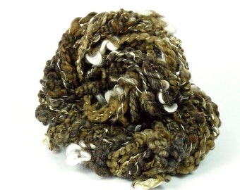 Gnarly. Very textured art yarn. Handspun art yarn, natural colors, add-ins: Pieces of fashion jewelry and Cotswold locks!