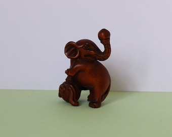 Unusual vintage carved wood signed Japanese netsuke type ball with carved dog possibly a massage stress ball?
