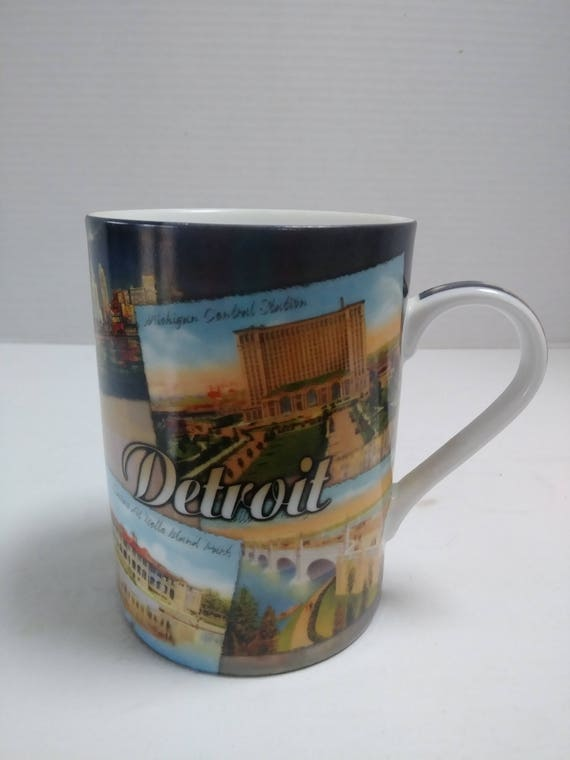 Vintage Detroit Souvenir Coffee Mug featuring many famous landmarks such as  Michigan Central Station, Ambassador Bridge, Masonic Temple