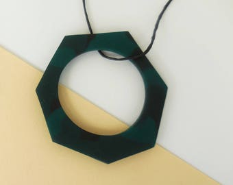 Geometric camouflage necklace in various shades of green, handmade of clay. Special and one off.