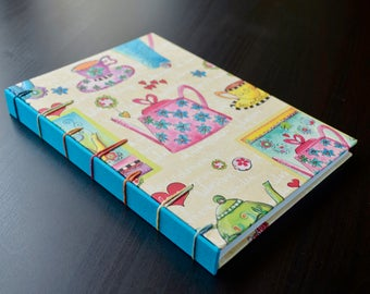 Cook Book - A5 size - Handmade recipe book - Secret Belgian binding. Boards covered in cloth, decorated paper and color printed sheets. Chef