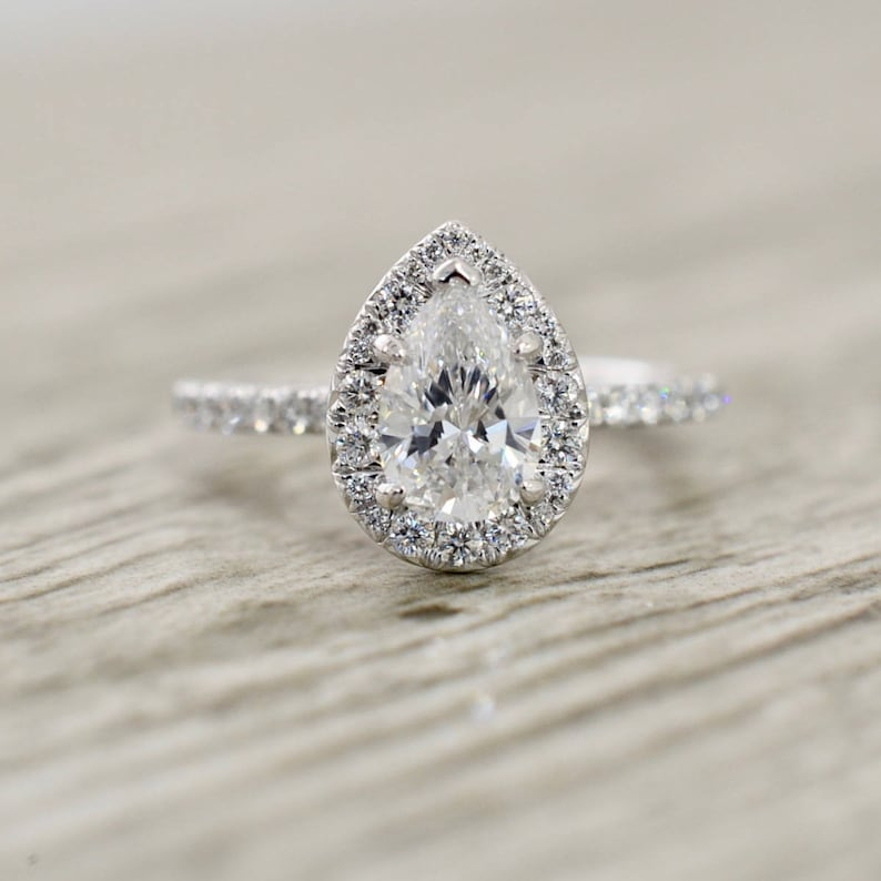 b5ea2480879d0 Pear Brilliant in a French Pavé Halo & Stem Engagement Ring in White