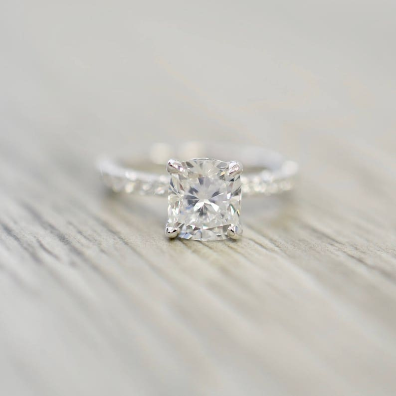 7d125b5b76332 Cushion Brilliant in a French Pavé Hidden Halo Engagement Ring in White