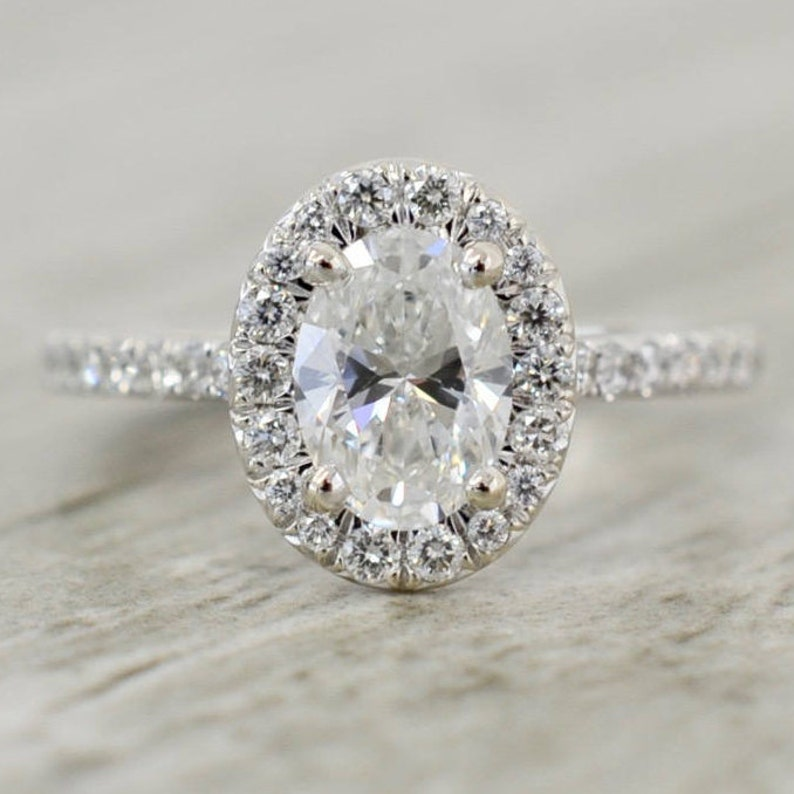 0ecf4d9f21f71 Oval Brilliant in a French Pavé Halo V-Gallery Engagement Ring in White