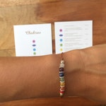 7 Chakra Adjustable bracelet with card-beads of semi-precious stones with silver Entrepiezas-card in English and Spanish