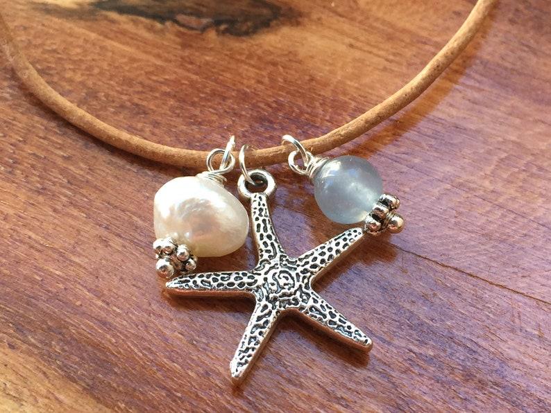 65b5c66db064 Collar de cuero con estrella de mar perla y cuenta de