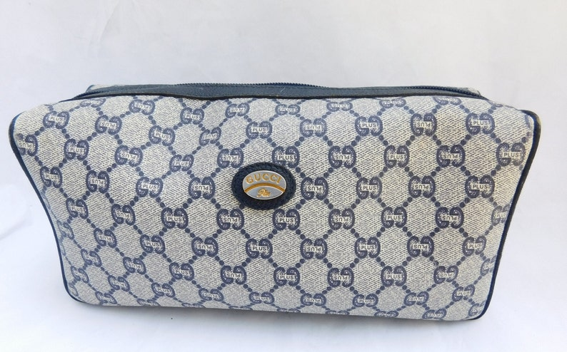 a5e0d1f1dd100 Vintage Gucci Plus Monogram GG Canvas Pouch Cosmetic Bag