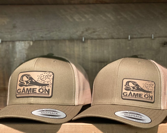 Waterfowl GAME ON! The green head cap is available in two different sizes of patches. A SnapBack trucker hat. One size fits most