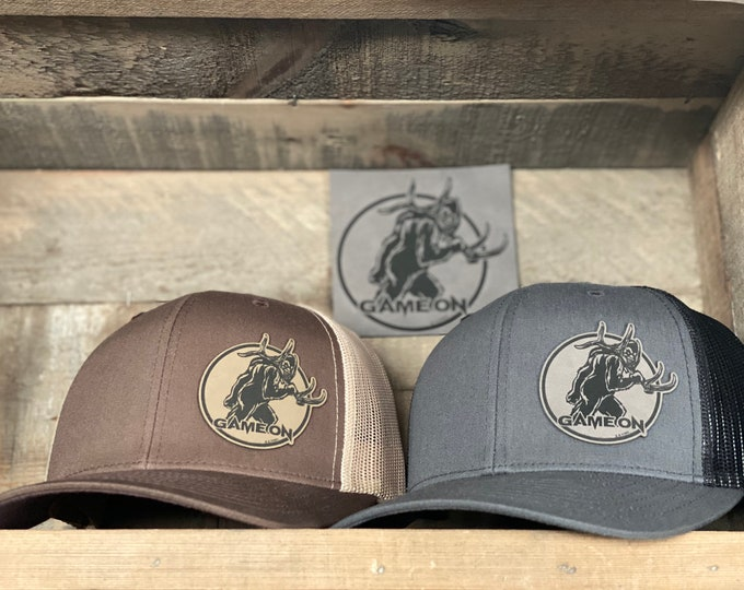 GAME ON! The legend taking all the sheds. A SnapBack trucker hat available in two colors. One size fits most