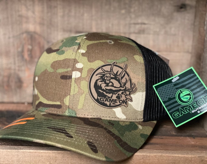 GAME ON! Deadhead Squatch SnapBack trucker hat available in two colors. One size fits most