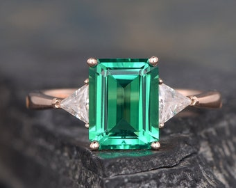 Emerald Cut Emerald Engagement Ring Rose Gold Trillion Cut Lab Emerald Ring Triangle Shaped Moissanite Unique Ring Three Stone Ring