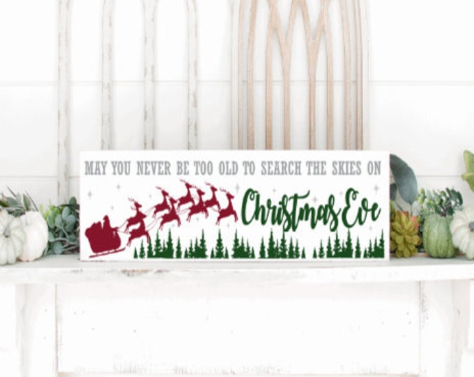 Wood Christmas sign. May you never be too old to search the skies on Christmas Eve.  Rustic Christmas sign. Santa Christmas signs.